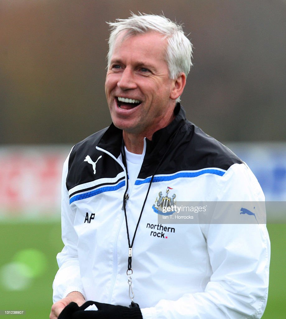 Newcastle United manager Alan Pardew smiles during a Newcastle United Training session at The Little Benton Training Ground on November 03, 2011 in Newcastle, United Kingdom.