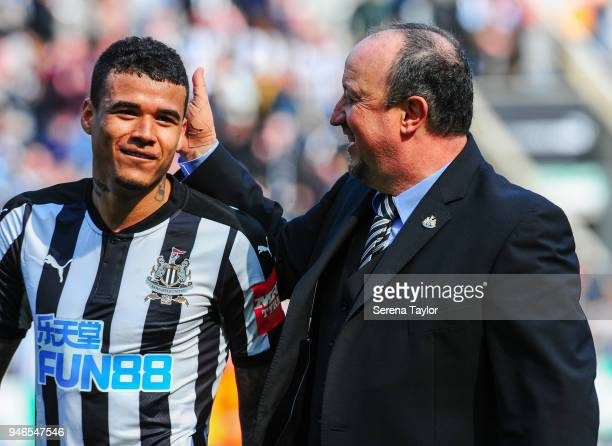 Newcastle United Manager Rafael Benitez greets Kenedy during the Premier League match between Newcastle United and Arsenal at StJames' Park on April...