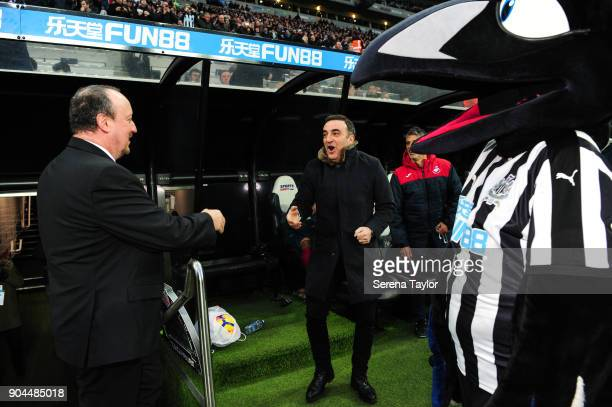 Newcastle United Manager Rafael Benitez greets Swansea City Manager Carlos Carvalhal during the Premier League match between Newcastle United and...