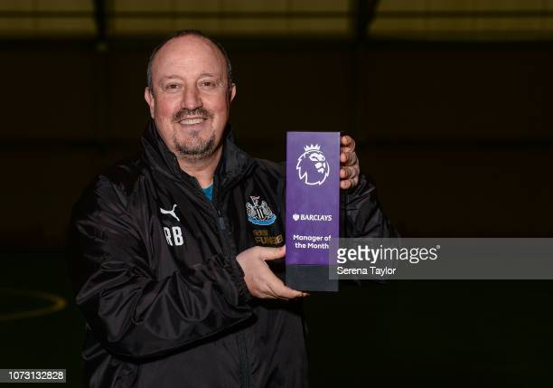 Newcastle United Manager Rafael Benitez poses for photographs as he is presented with an award for Winning the Barclays Manager of the Month Award at...