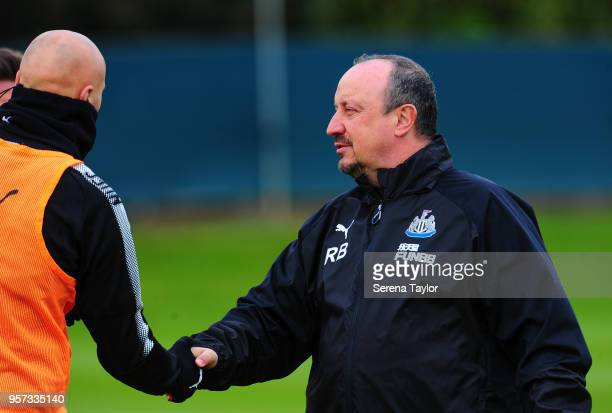 NEWCASTLE ENGLAND MAY Newcastle United Manager Rafael Benitez shakes hands with Jonjo Shelvey during the Newcastle United Training Session at the...