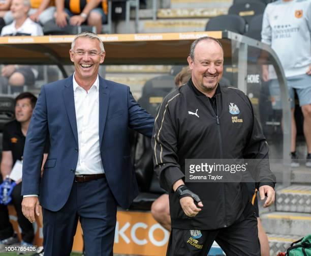 Newcastle United Manager Rafael Benitez shares a joke with Hull City AFC Head Coach Nigel Adkins during the pre season friendly between Hull City and...