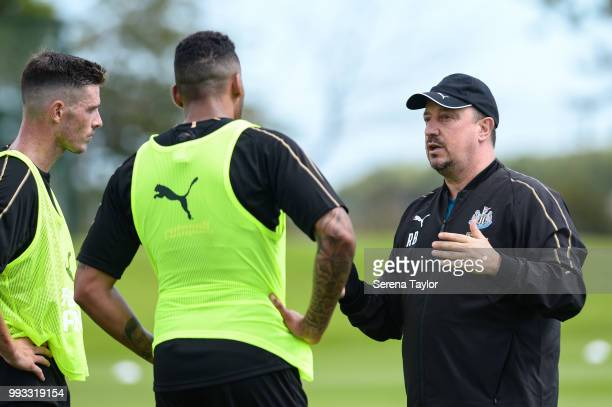Newcastle United Manager Rafael Benitez speaks to Ciaran Clark and Jamaal Lascelles during the Newcastle United Training Session at the Newcastle...