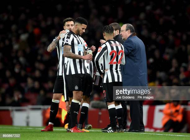 Newcastle United manager Rafael Benitez speaks with players Newcastle United's Jamaal Lascelles and Newcastle United's DeAndre Yedlin during the...