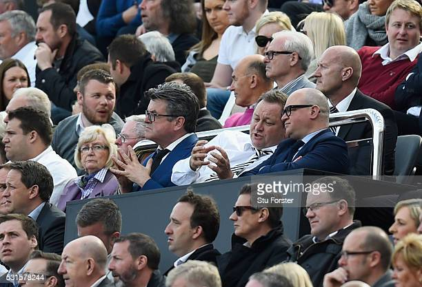 Newcastle United owner Mike Ashley and Managing Director Lee Charnley talk during the Barclays Premier League match between Newcastle United and...
