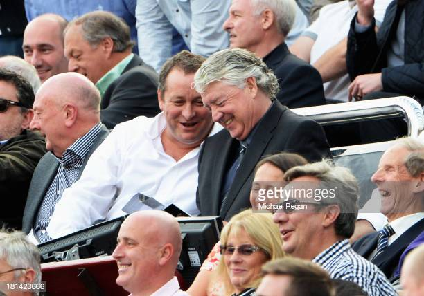 Newcastle United owner Mike Ashley and Newcastle United Director of Football Joe Kinnear look on during the Barclays Premier League match between...