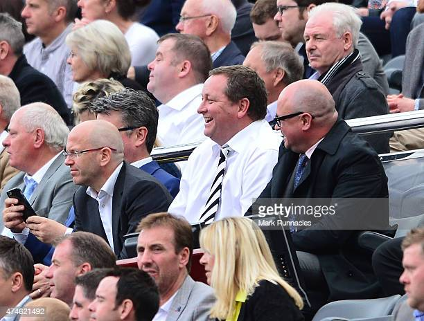 Newcastle United owner Mike Ashley smiles in the stand after the second goal during the Barclays Premier League match between Newcastle United and...