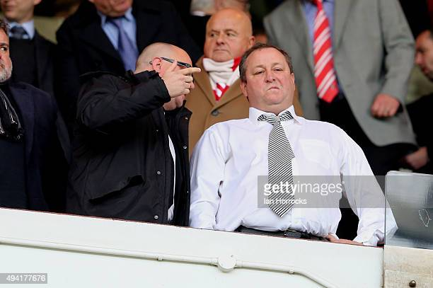Newcastle United owner Mike Ashley talks to Managing Director Lee Charnley during the Barclays Premier League match between Sunderland AFC and...