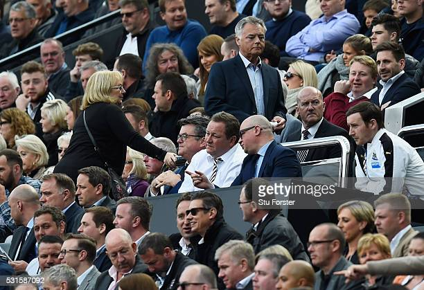 Newcastle United owner Mike Ashley talks with managing director Lee Charnley during the Barclays Premier League match between Newcastle United and...