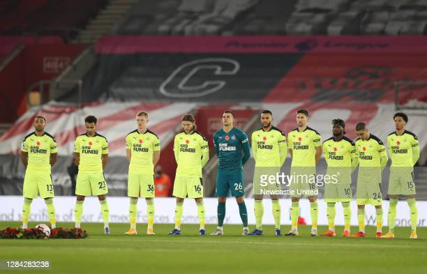 Newcastle United plaeyers observe a minute of silence to mark Armistice Day prior to the Premier League match between Southampton and Newcastle...