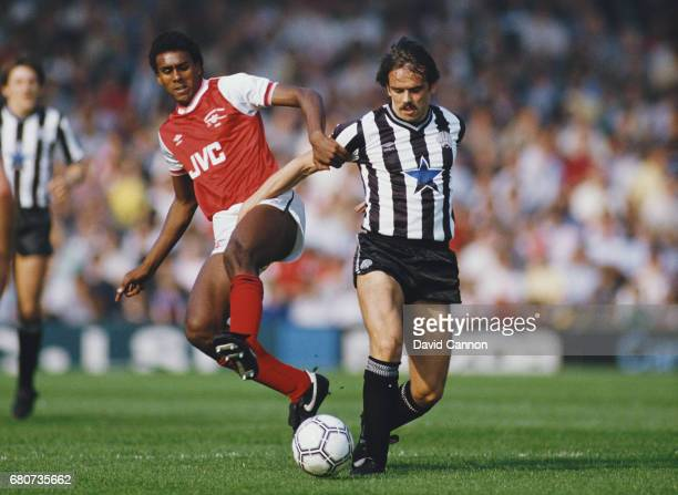 Newcastle United player Alan Davies is challenged by David Rocastle of Arsenal during a Canon League Divsiion One match at Highbury on September 28...
