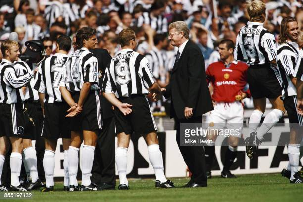 Newcastle United player Alan Shearer meets Graham Kelly as David Ginola looks on before the 1996 FA Charity match against Manchester United at...