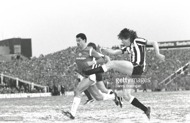 Newcastle United player Chris Waddle gets in a shot at goal on a snow covered pitch as Manchester United defender Paul McGrath looks on during the...