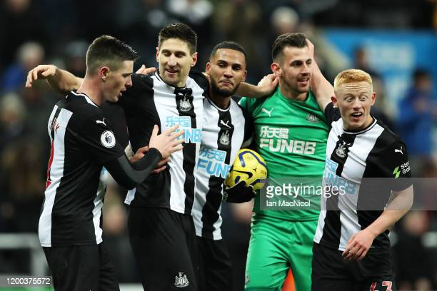 Newcastle United players celebrate during the Premier League match between Newcastle United and Chelsea FC at St James Park on January 18 2020 in...
