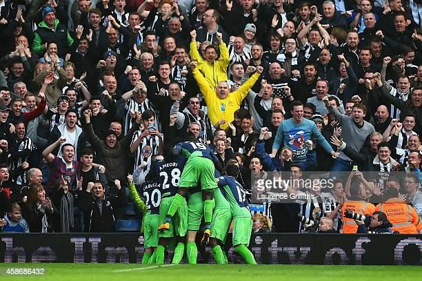 Newcastle United players celebrate in fron tof fans as Fabricio Coloccini scores their second goal during the Barclays Premier League match between...
