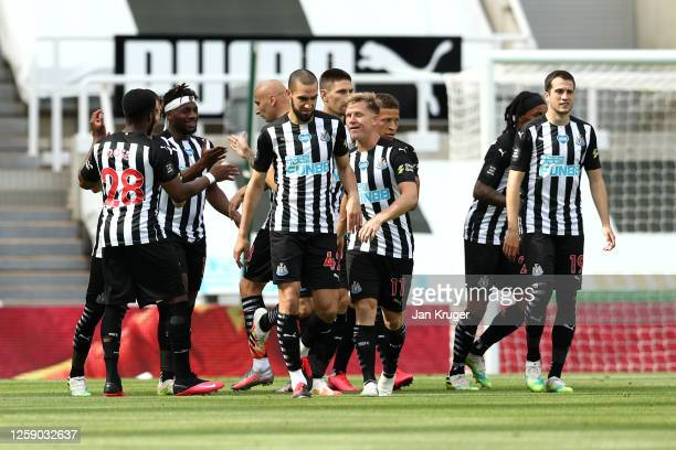 Newcastle United players celebrate their team's first goal during the Premier League match between Newcastle United and Liverpool FC at St. James...