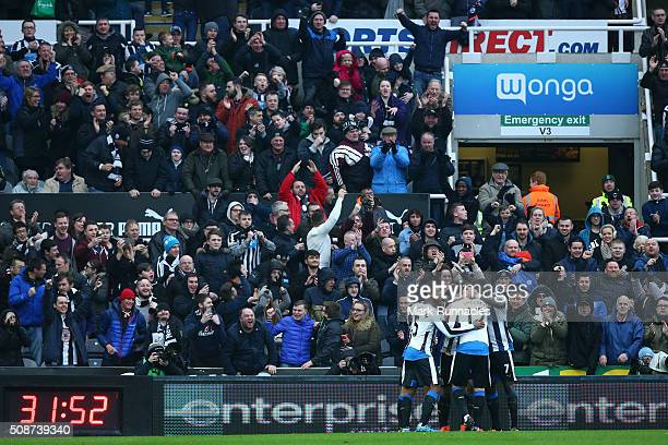 Newcastle United players celebrates a goal from Aleksandar Mitrovic in front of the home crowd during the Barclays Premier League match between...