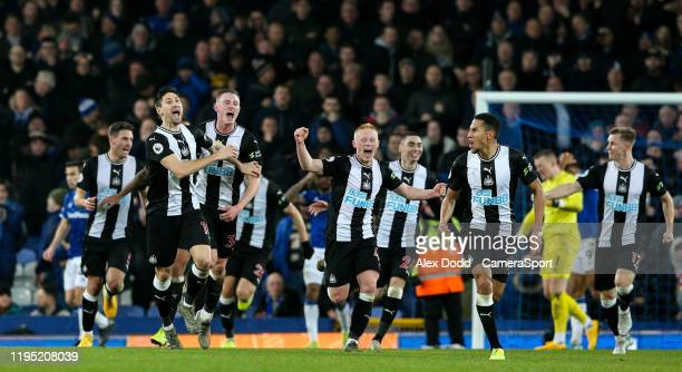 Newcastle United players celebrates a late equaliser during the Premier League match between Everton FC and Newcastle United at Goodison Park on...