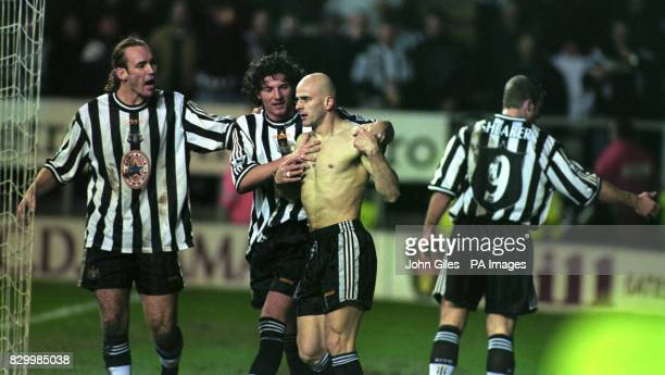 Newcastle United players Darren Peacock and Alessandro Pistone calm down Temuri Ketsbaia after he scored the winning goal for Newcastle against...