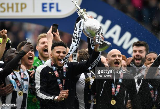 Newcastle United players Jamaal Lascelles and Jonjo Shelvey lift the trophy after winning the Sky Bet Championship title after the match between...
