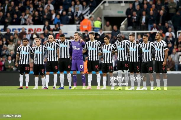 Newcastle United Players line up around the centre circle for a minute's silence ahead of Armistice day prior to the Premier League match between...