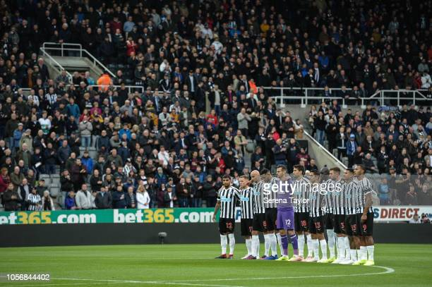 Newcastle United players line up for a minutes silence during the Premier League Match between Newcastle United and Watford FC at StJames Park on...