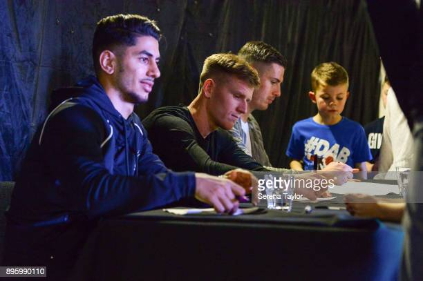 Newcastle United players seen LR Ayoze Perez Matt Ritchie and Ciaran Clark sign autographs for young academy children during the Newcastle United...