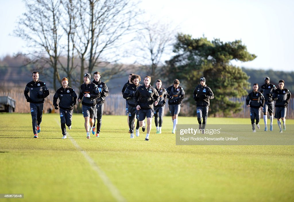 Newcastle United players warm up during a training session at The Newcastle United Training Centre on December 19, 2014 in Newcastle upon Tyne, England.