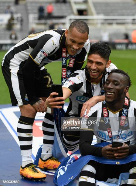 Newcastle United players Yoan Gouffran Massadio Haidara and Achraf Lazaar celebrate by taking selfie photographs after winning the Sky Bet...