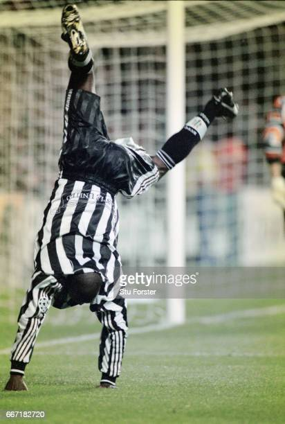 Newcastle United striker Faustino Asprilla does his trademark cartwheel celebration after scoring his and Newcastle's second goal with a bullet...