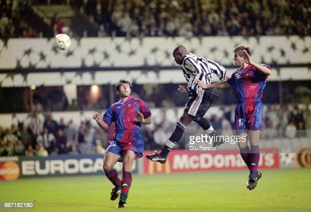 Newcastle United striker Faustino Asprilla leaps between Barcelona players Nadal and Sergi Barjuan to head the third Newcastle goal and his hat trick...