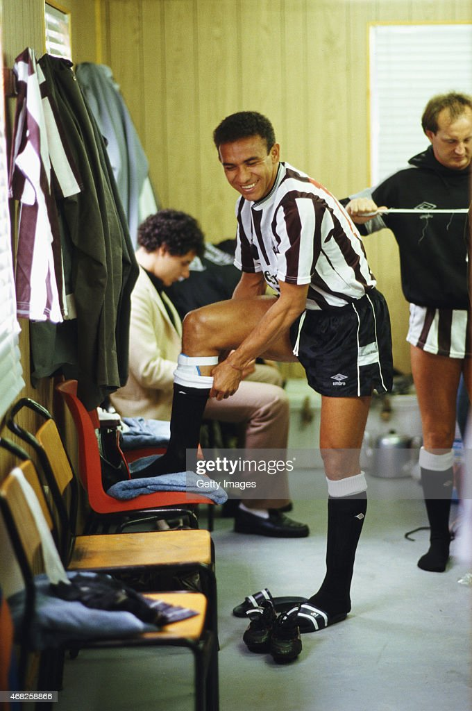 Newcastle United striker Francisco Ernani Lima da Silva, better known as Mirandinha enjoys a joke as he prepares in the temporary portacabin dressing room for his home debut in a League Division One match against Wimbledon at St James' Park on September 5, 1987 in Newcastle, England, Mirandinha signed for ?575,000 and was the first Brazilian to play in English football, scoring 24 times in 58 starts for the club, also in the picture is his translator Roberto Silva (l) and midfielder David McCreery.