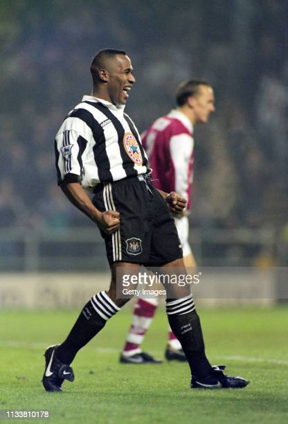 Newcastle United striker Les Ferdinand celebrates after scoring during the Premier League match against Arsenal at St James' Park on January 4, 1996...