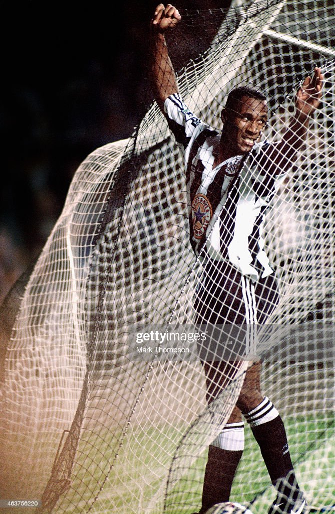 Newcastle United striker Les Ferdinand celebrates in the back of the net after heading the winning goal against Middlesbrough in the Premiership match at St James' Park on August 30, 1995 in Newcastle, England.