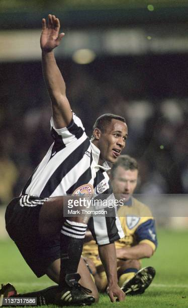 Newcastle United striker Les Ferdinand celebrates one of his two goals as Spurs defender Colin Calderwood looks on during Newcastle's 7-1 Premier...