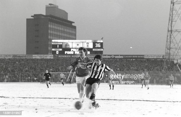 Newcastle United striker Peter Beardsley gets in a shot at goal despite the attentions of Foxes defender Russell Osman and the snow covered pitch...