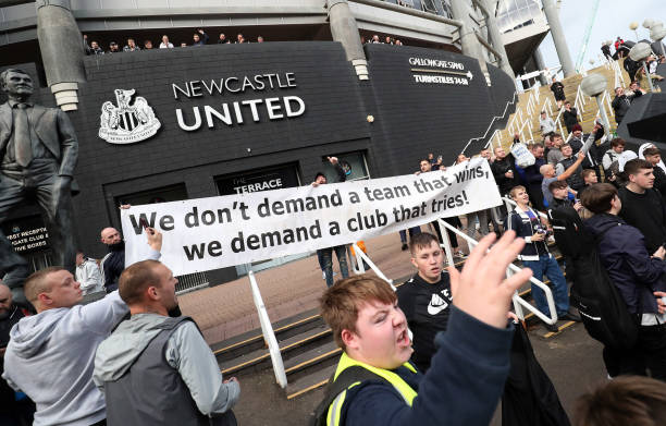 Newcastle United supporters celebrate outside the club's stadium St James' Park in Newcastle upon Tyne in northeast England on October 7 after the...