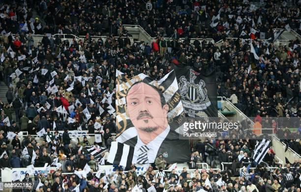 Newcastle United supporters celebrate the clubs 125th anniversary with a huge banner of Manager Rafa Benitez at St James Park ahead of the Premier...