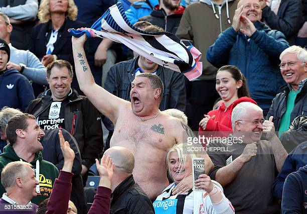 Newcastle United supporters celebrate their win over Spurs in the stands after the English Premier League football match between Newcastle United and...