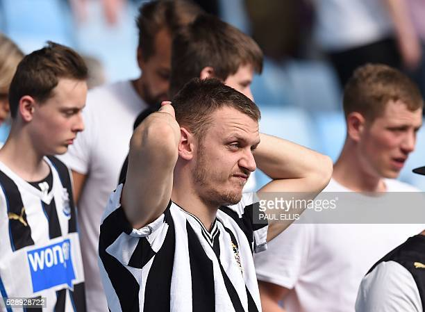 Newcastle United supporters react to the news that their rivals Sunderland have won putting them in danger of relegation after the English Premier...