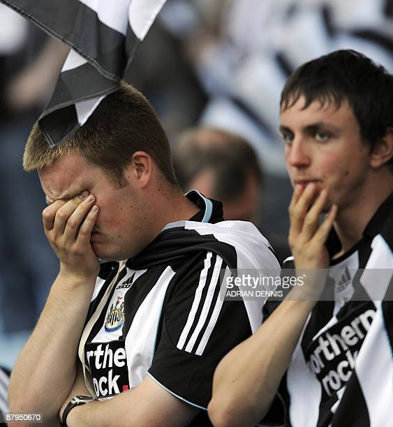 Newcastle United supporters show their disappointment following the final Premiership match of the season at Villa Park in Birmingham on May 24,...
