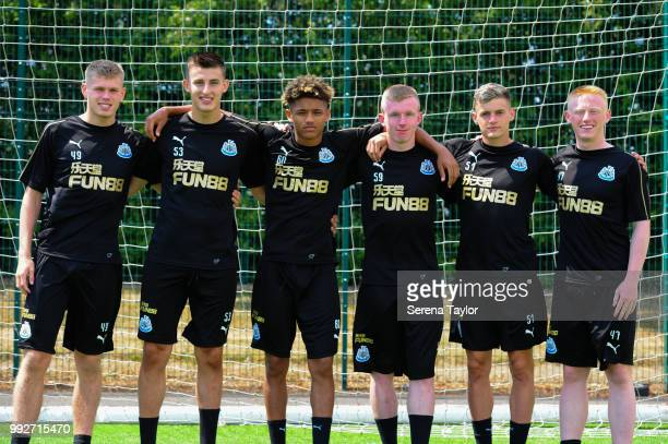 Newcastle United U23 players seen LR Lewis Cass Kelland Watts Adam Wilson Oliver Walters Tom Allan and Matty Longstaff pose for a photograph after...