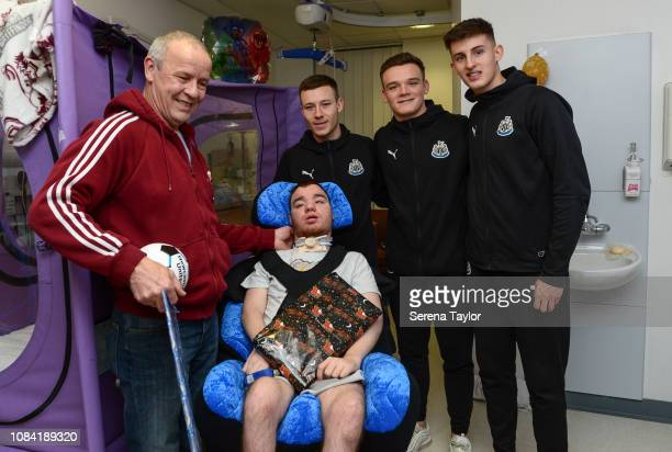 Newcastle United Under Twenty one Players seen LR Callum Roberts Owen Bailey and Kelland Watts Visit the RVI to Deliver Christmas Gifts and pose for...
