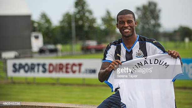 Newcastle United unveil summer signing Georginio Wijnaldum holding a Newcastle United Shirt at The Newcastle United Training Centre on July 10 in...