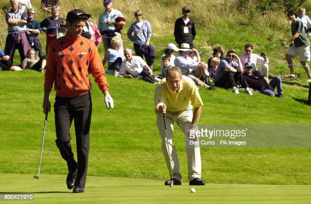 Newcastle United's Alan Shearer gets some advice from Jesper Parnevik during the Roxburghe Challenge 2000 at the Roxburgh Golf Course near Kelso The...
