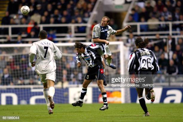 Newcastle United's Alan Shearer wins an aerial dual with Juventus' Alessio Tacchinardi