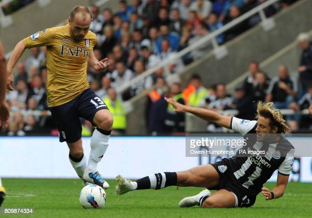 Newcastle United's Alan Smith tackles Fulham's Danny Murphy during the Barclays Premier League match at St James' Park Newcastle