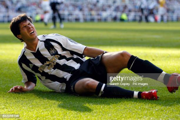 Newcastle United's Albert Luque lies injured during the game