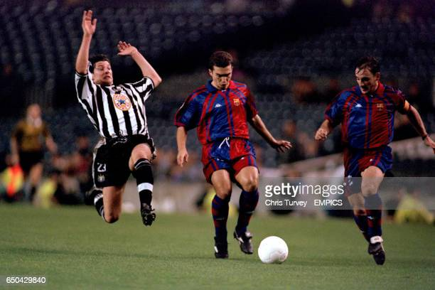 Newcastle United's Alessandro Pistone dives in to tackle Barcelona's Guillermo Amor