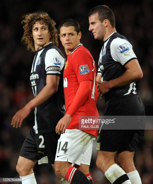Newcastle United's Argentinian defender Fabricio Coloccini and English defender Steven Taylor surround Manchester United's Mexican striker Javier...